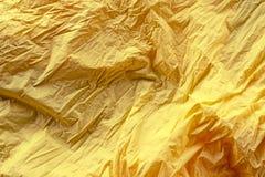 Abstrakt ljus för textildefocus för rich gul bakgrund skrynkligt utrymme för kopia för bästa sikt royaltyfri foto