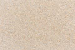 Abstrakt ljus sandtextur på stranden för bakgrund Fotografering för Bildbyråer