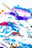 Abstrakt målarfärg och målarpensel Arkivfoton