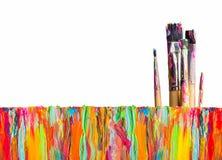 Abstrakt målning med målarfärgborstar Arkivbild
