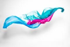 Abstrakt mångfärgat tyg vinkar in Arkivbild