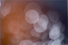 Abstrakt mörker och ljus - brun bokehbakgrund Arkivfoton