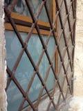 Abstrakt medeltida gallerförsett fönster Royaltyfri Fotografi