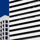 Abstrakt minsta stilarkitektur modern byggnadsfacade Royaltyfri Foto