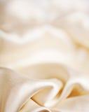 Abstrakt mjuk guld- tygbakgrund Fotografering för Bildbyråer