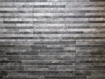 Abstrakt modellvägg som göras av tegelstenar för kvarter för gråa granitstenar tunna royaltyfria bilder