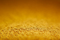 Abstrakt mousserande guld- bakgrund med guld- bollar Fotografering för Bildbyråer