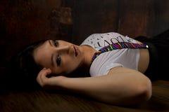 Abstrakt nätt flicka på trägolv Fotografering för Bildbyråer