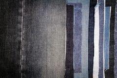 Abstrakt olik bakgrund för jeansbandtextur royaltyfri foto