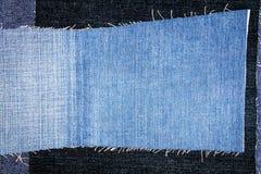 Abstrakt olik bakgrund för jeansbandtextur arkivfoto