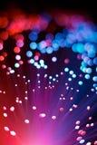 Abstrakt optisk bakgrund för begrepp för fiberrosa färg- och blåttteknologi Arkivfoto