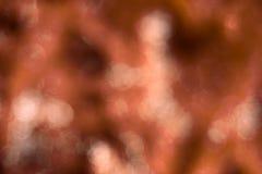 Abstrakt orange bakgrund med bokeh Royaltyfri Bild