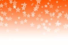 Abstrakt orange bokehstjärnabakgrund Royaltyfri Foto