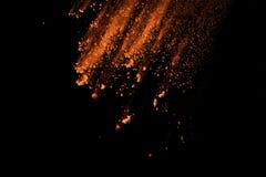 Abstrakt orange dammexplosion på svart bakgrund Fotografering för Bildbyråer