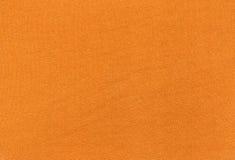 Abstrakt orange textiltextur Fotografering för Bildbyråer