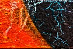 Abstrakt orange texturbakgrund med sprucken yttersida Arkivfoton