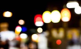 Abstrakt oskarp belysninglampa i marknad Arkivbild