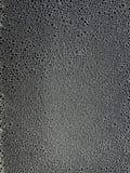 Abstrakt piankowa tekstura na czarnym tle z bąblami, fotografia stock