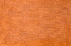 Abstrakt plast- orange texturbakgrund Royaltyfria Bilder
