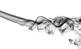Abstrakt puff av svart rök på vit arkivfoto