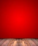 Abstrakt röd bakgrund med det wood golvet Arkivfoto