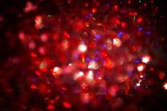 Abstrakt röd blinkad julbakgrund Arkivfoton