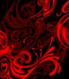 Abstrakt röd brand virvlar runt på svart bakgrund Arkivfoton