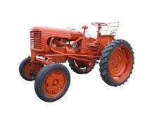 Abstrakt röd gammal traktor som isoleras över vit Arkivbilder