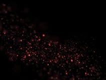 Abstrakt rött blänker explosion på svart bakgrund Arkivbild