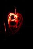 Abstrakt rött för målningbb för orange ljus motiv för hjärta på svart bakgrund fotografering för bildbyråer