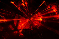 Abstrakt rött ljusbristningszoom Arkivfoto