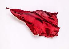 Abstrakt rött tyg i rörelse arkivfoton