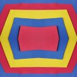 abstrakt ram med skummande utklipp i röda, blåa och gula färger Arkivbild