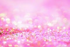 Abstrakt rosa ljus Bokeh bakgrundsguld Arkivbild