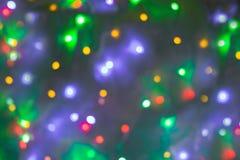 Abstrakt rund bokehbakgrund av julljus Arkivfoton