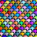 Abstrakt sömlös modell som består av mång--färgade stjärnor Arkivfoto