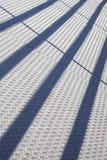 Abstrakt sammansättning med den metalliska textur och linjen skuggor Fotografering för Bildbyråer