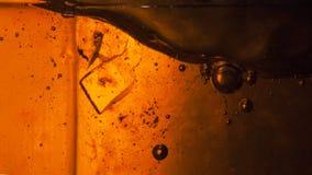 Abstrakt sammansättning med sockerkuber i en krus Fotografering för Bildbyråer