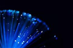 Abstrakt sfärisk bakgrund, prickar och linjer för optisk fiber blåa lysande royaltyfria foton