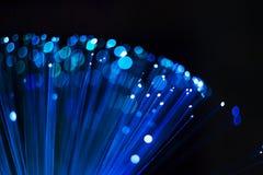 Abstrakt sfärisk bakgrund, prickar och linjer för optisk fiber blåa lysande arkivfoton