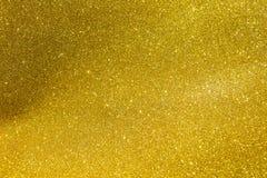 Abstrakt skinande guld blänker texturbakgrund Royaltyfria Bilder