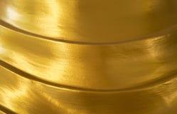 Abstrakt skinande guld- texturbakgrund Arkivfoto