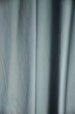 Abstrakt skugga och ljus på blå bakgrund arkivfoton