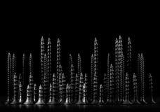 Abstrakt stad av skruvar på svart bakgrund Royaltyfri Foto