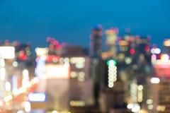 Abstrakt stad som är suddig i natten för bakgrund Royaltyfri Fotografi