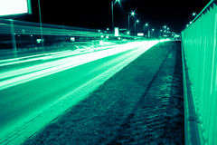 abstrakt stadsnatthastighet Arkivfoto