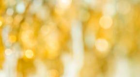 Abstrakt suddig bakgrund av guld- textur Arkivbild