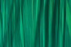 Abstrakt suddig bakgrund för rörelse med vertikala linjer i cyan toner arkivfoto