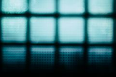 Abstrakt suddig bakgrund för turkos Väggen av glass kvarter Royaltyfria Foton