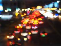 Abstrakt suddig bakgrund med hjärtabokeh av trafikljus Fotografering för Bildbyråer